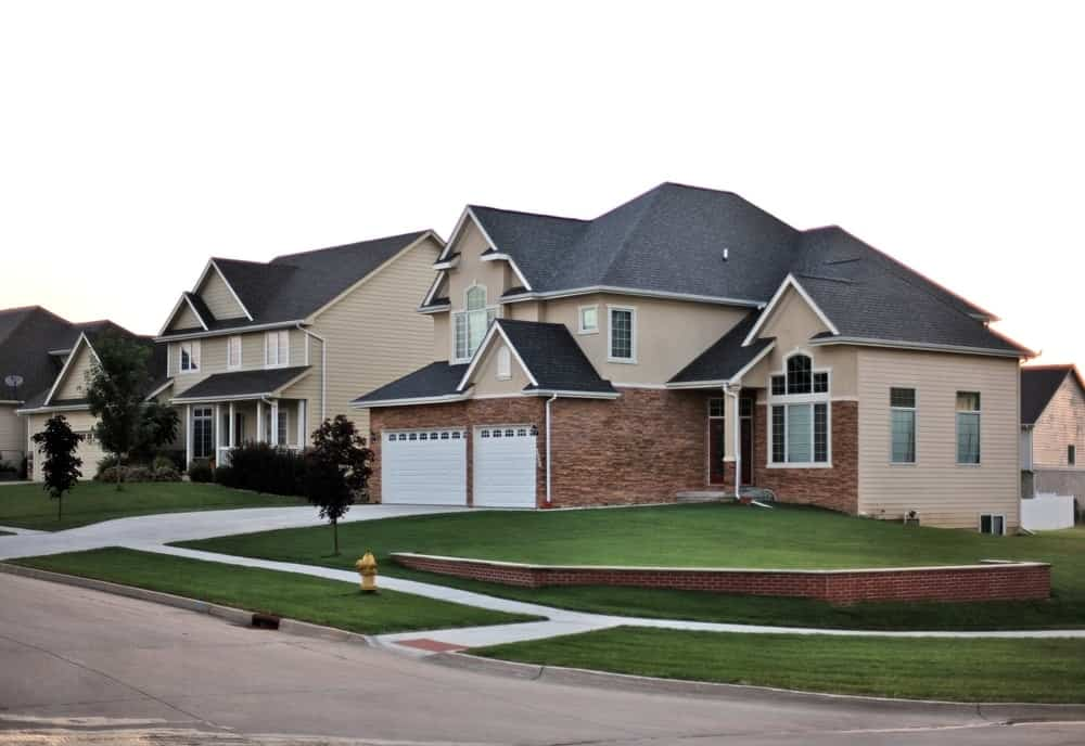 A look at a corner lot home in a suburban neighborhood.