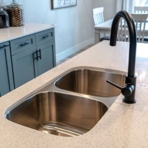A look at a stainless steel under mount double basin kitchen sink.