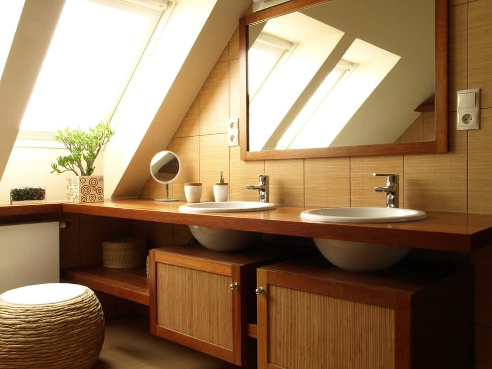 A look at the bathroom with a two-sink wooden vanity with under mount sinks.