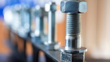 A close look at a row of anchor bolts.
