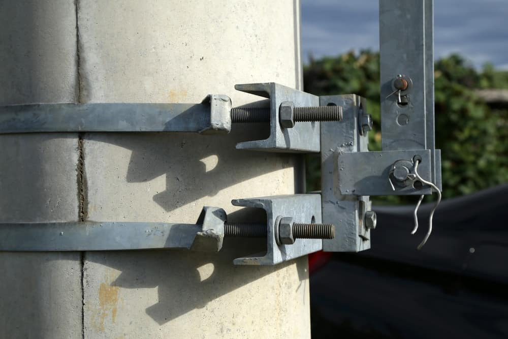 A close look at carriage bolts on an electric pylon.