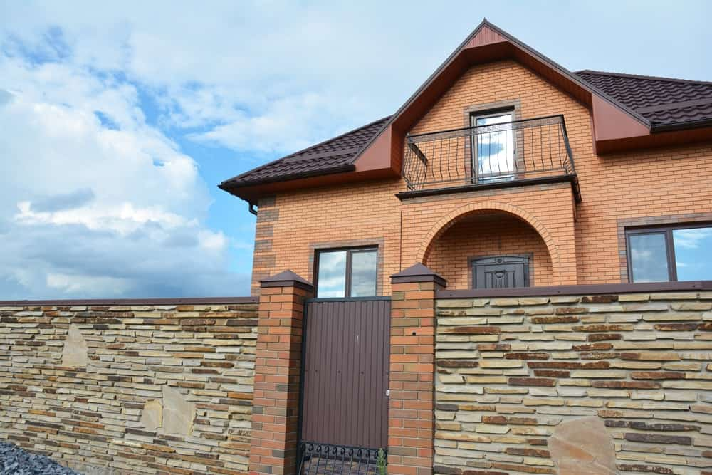 A modern brick home with tiled bonnet roof.