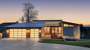 This is a home that glows warmly and has a clerestory roof.