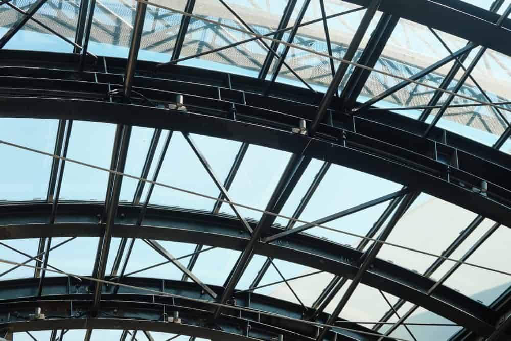 A close look at the metal and glass structures of a clerestory roof.