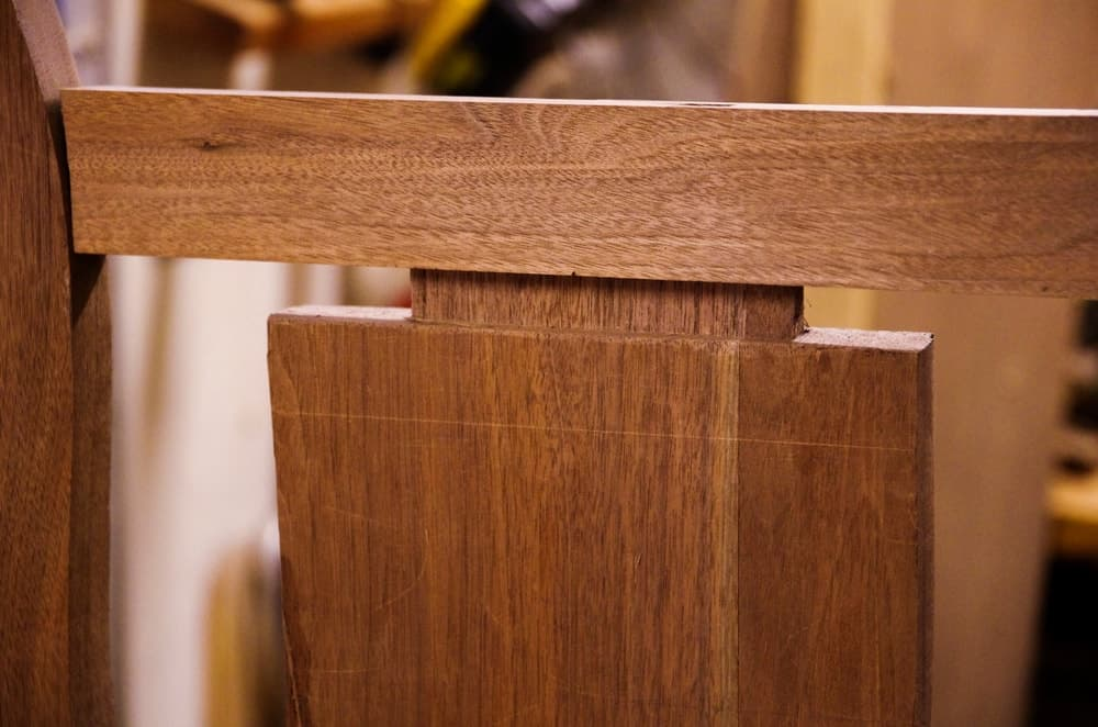 This is a close look at the backrest of a wooden chair with mortise and tenon joint.