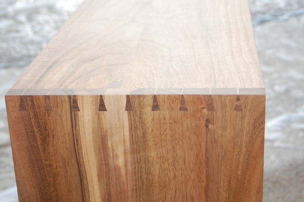A close look at a wooden box with dovetail joints.