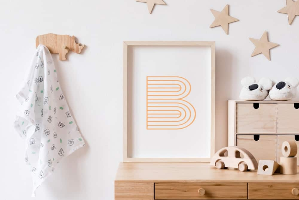 A decorative playroom setup with wooden elements as well as a shadow box picture frame.