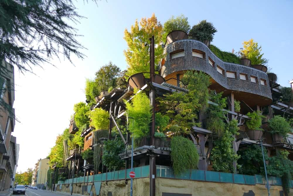 This is a look at the large residential building with an abundance of plants on its exteriors.