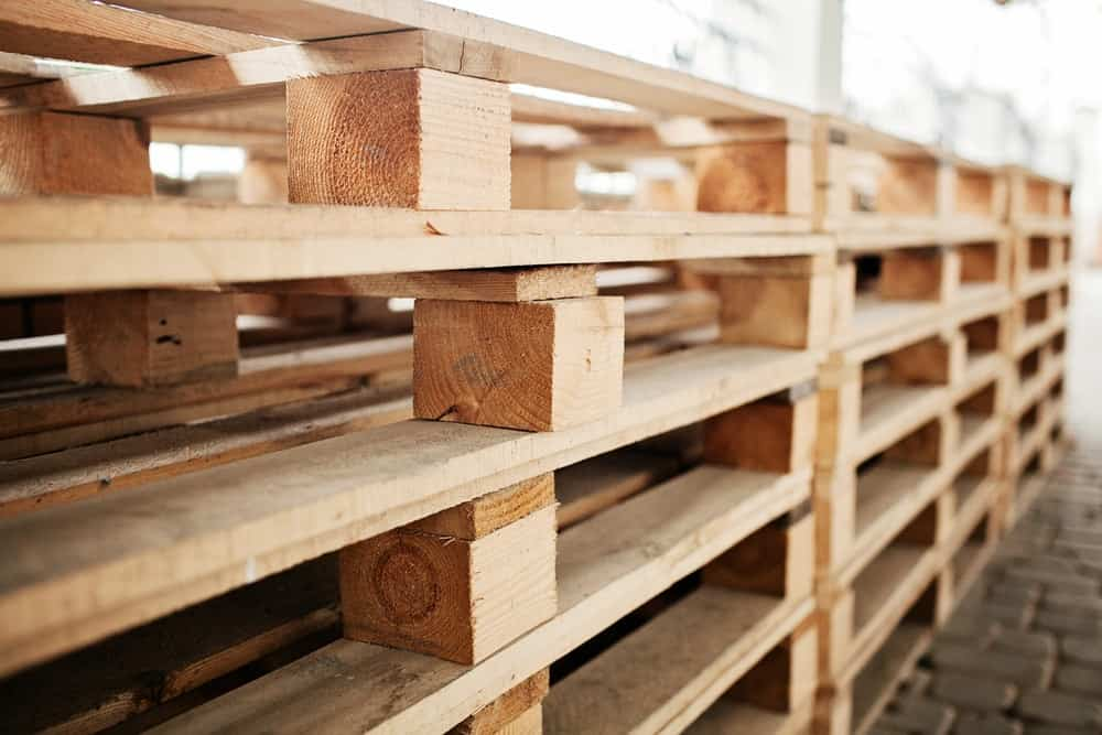 A close look at stacks of wooden pallets on display.