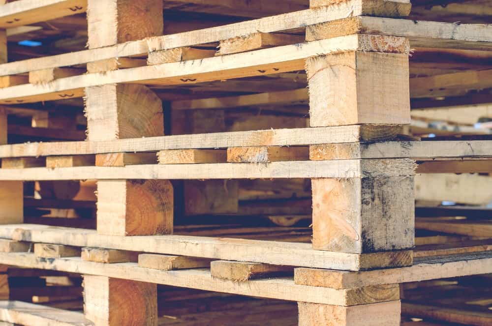 This is a close look at a few wooden pallets stacked on top of each other.