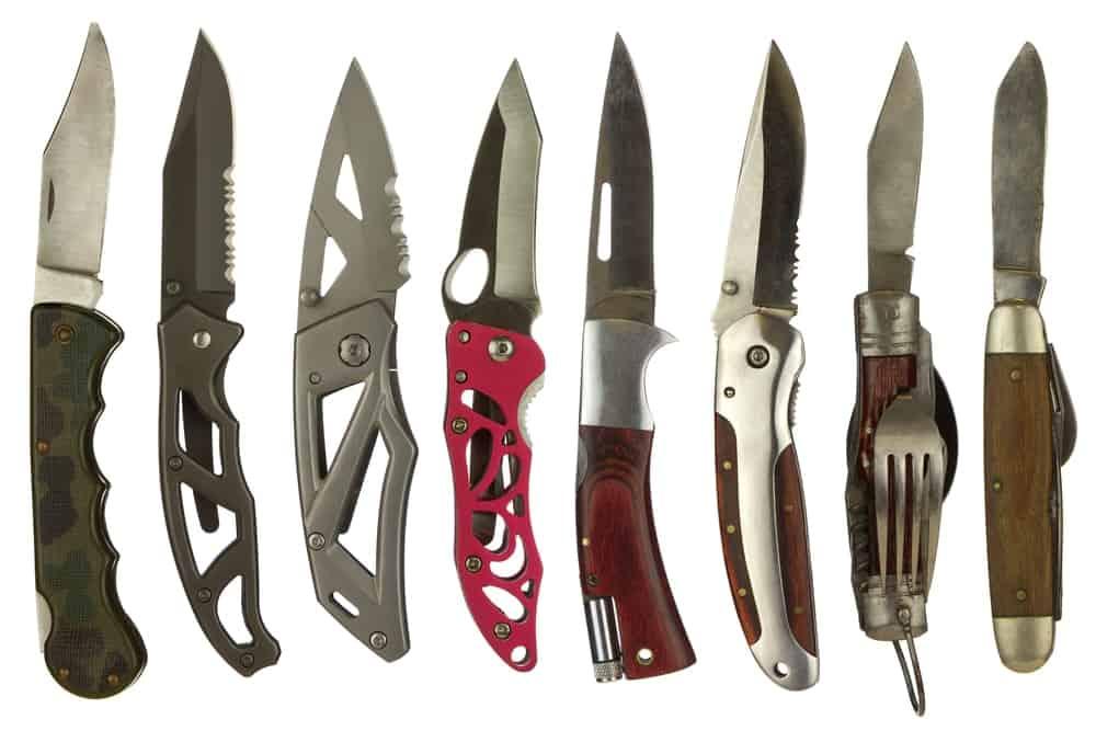 A close look at various different pocket knives.