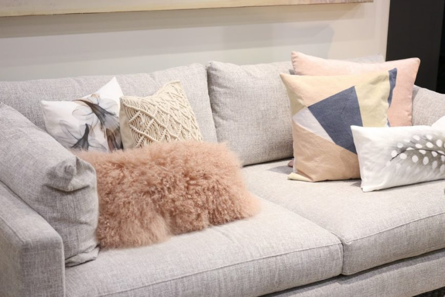 A close look at a comfortable beige loveseat.