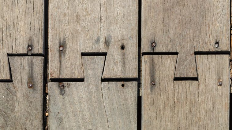This is a close look at an old wooden flooring with butt joints.