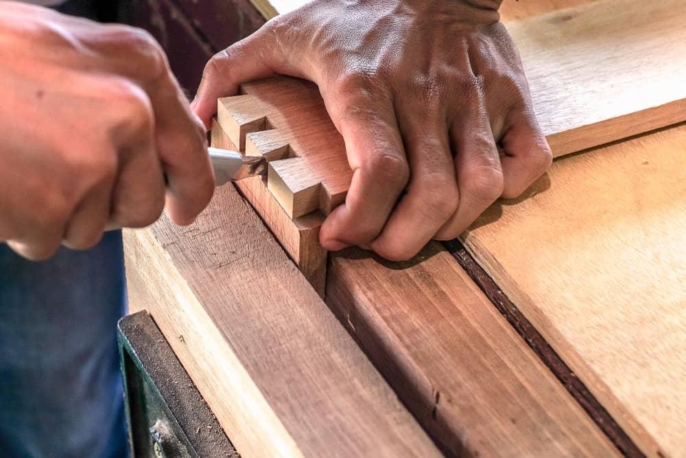 A close look at a carpenter doing a butt joint.