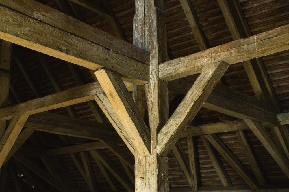 A look at an old wooden beamed ceiling.