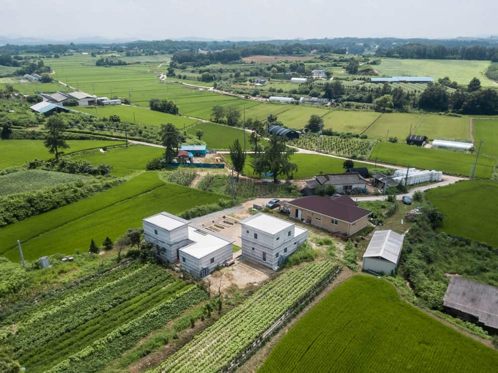 This is an aerial view of the house showcasing the lush landscape that surrounds it.