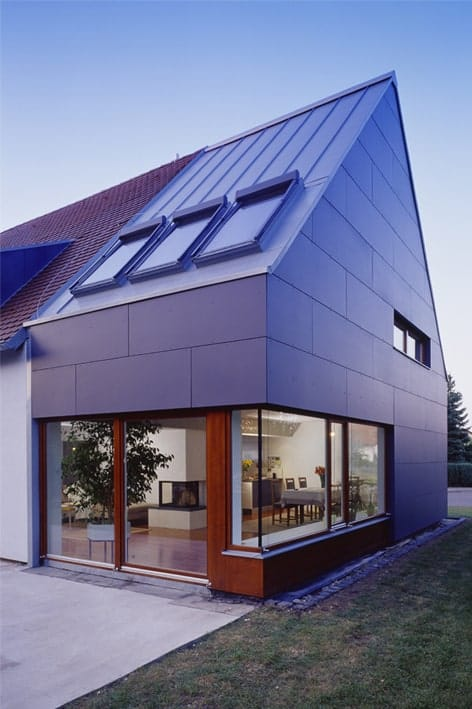 This side of the house showcases the three skylights and the section of the house with large glass windows and doors.