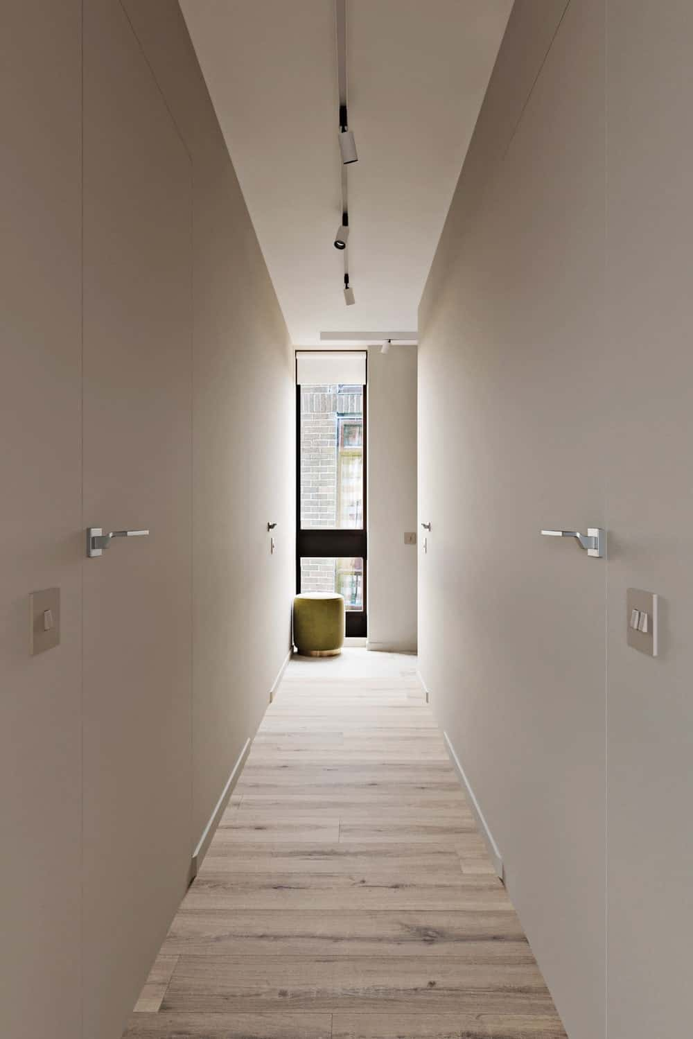 The light beige doors seem to blend well with the surrounding beige walls marked only by their stainless steel knobs.
