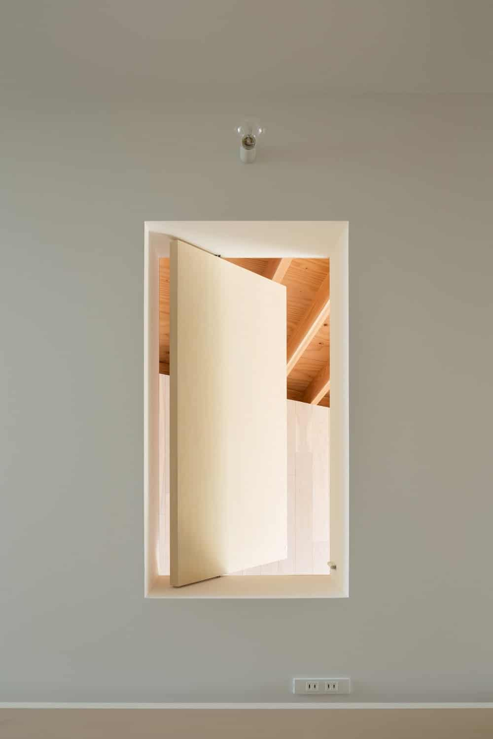 This is a close look at a window inside the house with a consistent beige tone.