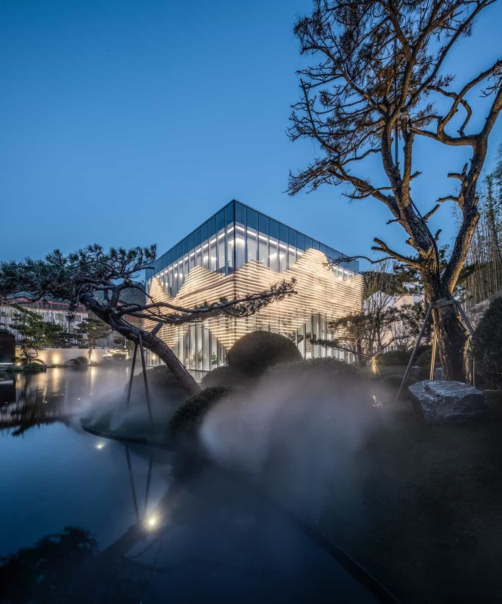 This is a look at the brilliant glass building complemented by the surrounding fog and zen garden.
