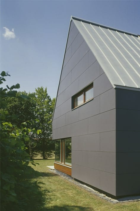 This is a closer look at the modern gray tone of the house complemented by the small window.