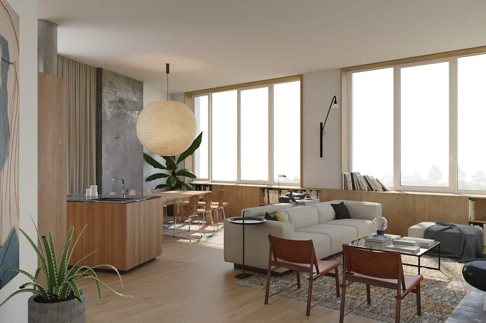 This view shows the large beige sofa of the living room and the wooden dining set at the far corner. These are then complemented by the large glass walls on the far wall.