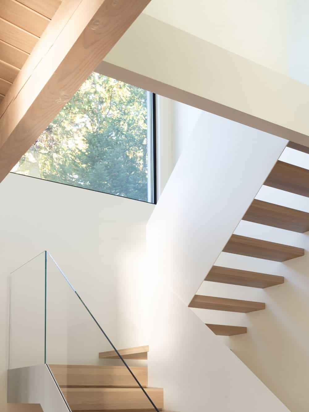 This is a closer look at the staircase with a unique and simple floating design to its wooden steps.
