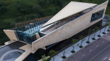 This side of the aerial view shows more of the covered rooftop area as well at the glass walls.