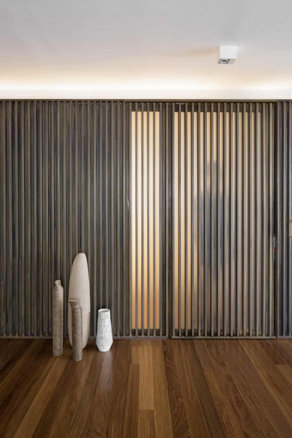 This is what the slatted wall looks like when the lights of the room behind it is turned on.