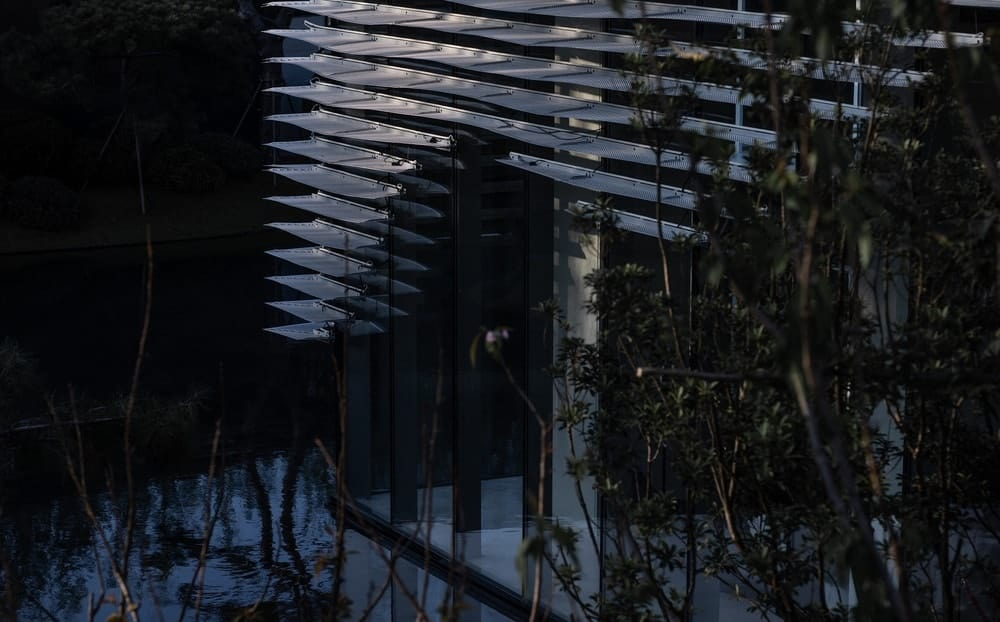 This is a close look at the structure attached to the glass walls of the building giving it a unique aesthetic.