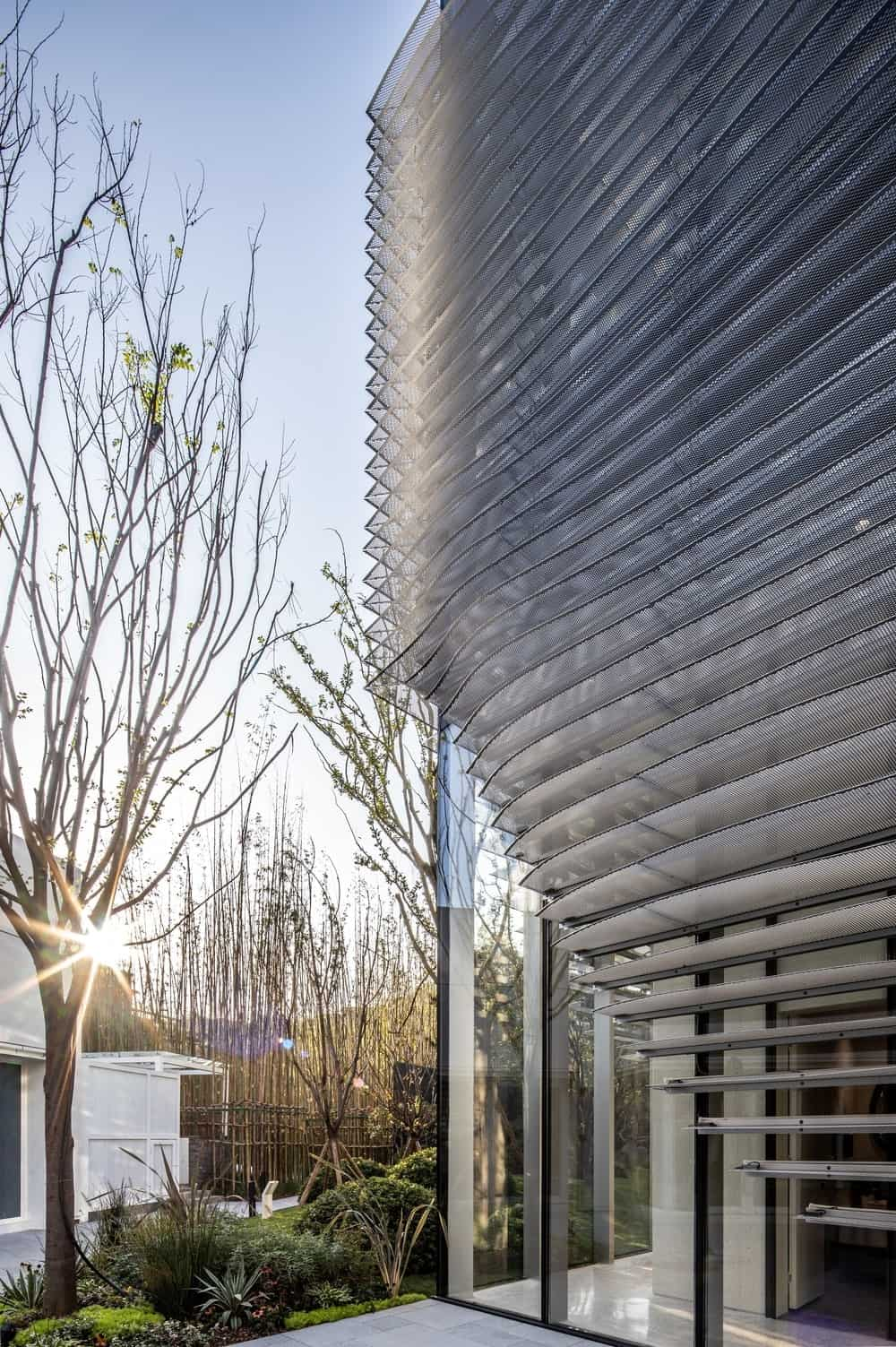 This is a view of the zen-like landscape that pairs quite well with the modern look of the glass building.