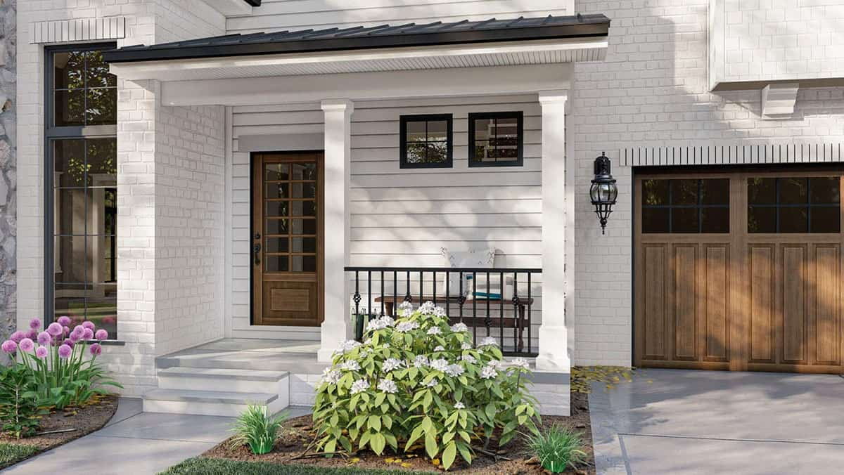 Home entry with a covered porch and a wooden glazed front door.