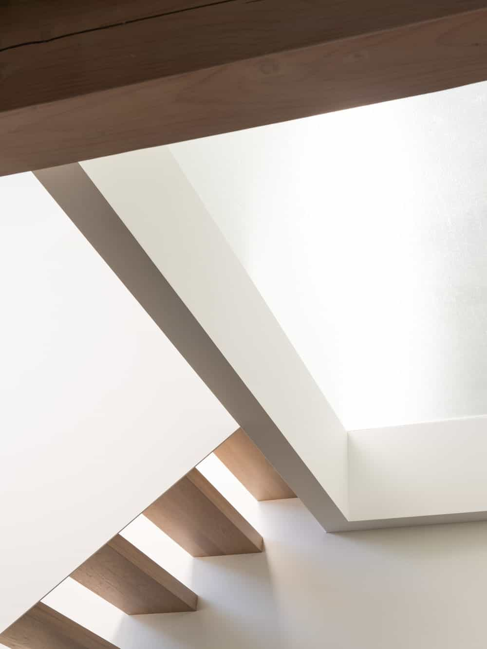 This is a closer looka t the bright white coffered ceiling above the staircase landing.