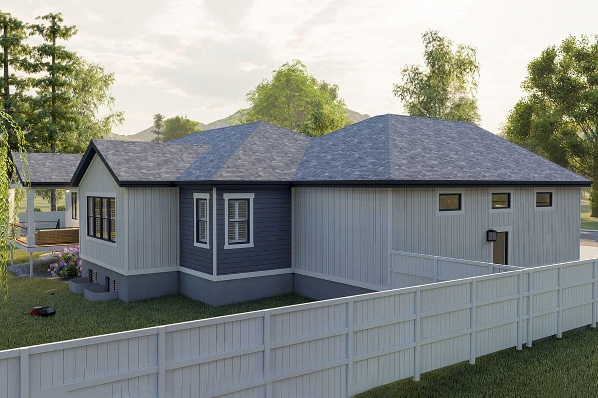 Side exterior view with hipped roofs and a combination of horizontal and vertical siding.
