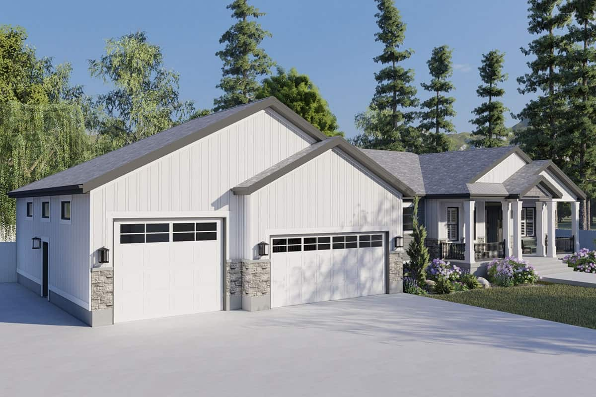 A closer look at the three-car garage clad in board and batten siding with stone accents.
