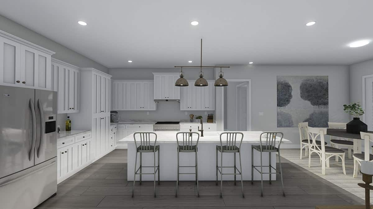 The kitchen is equipped with slate appliances, white cabinetry, marble countertops, and a breakfast island.