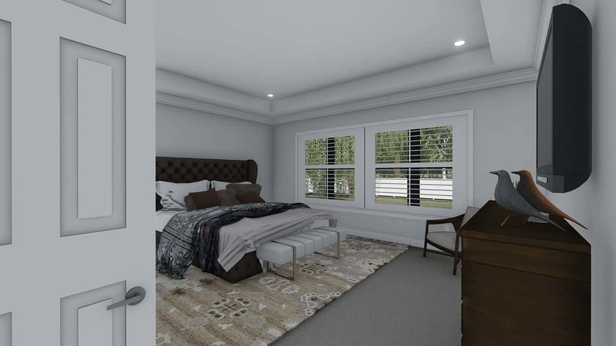 A white door opens to the primary bedroom that's crowned with a tray ceiling.