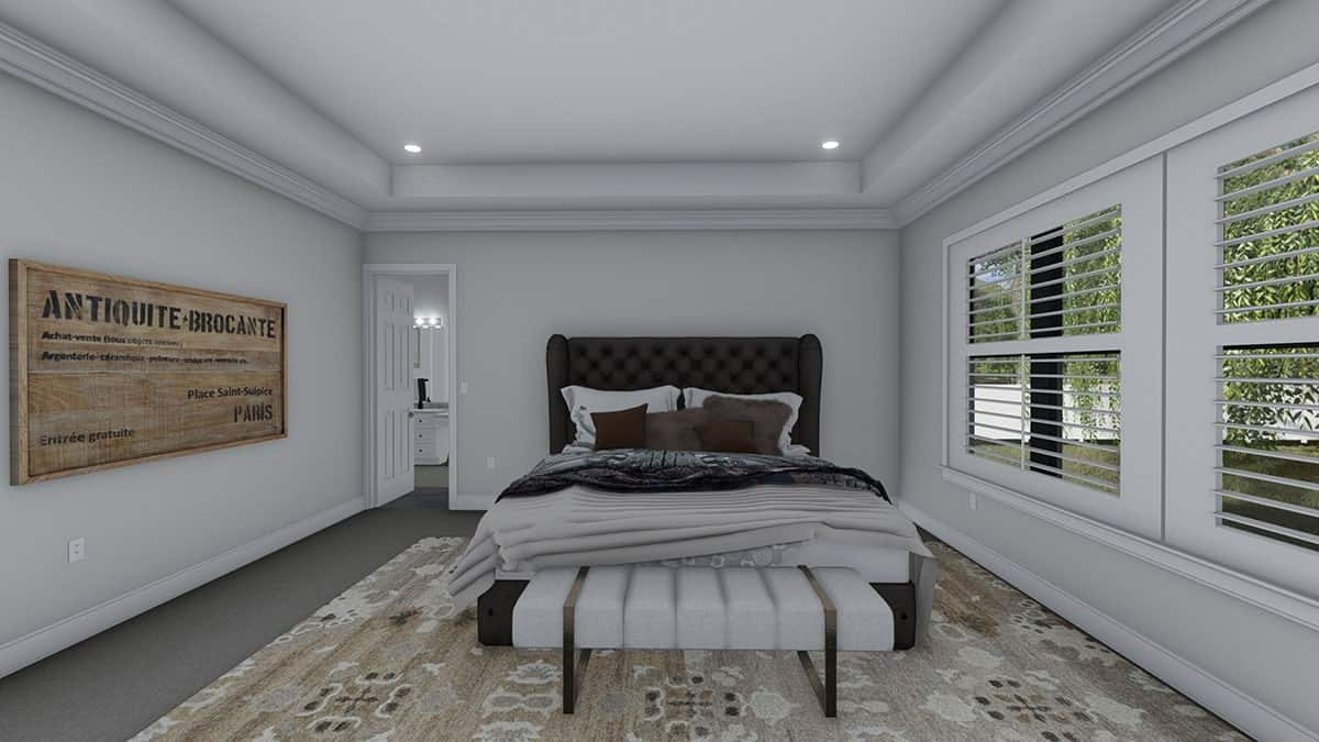 The primary bedroom has a tufted wingback bed and a cozy bench sitting on a patterned area rug.