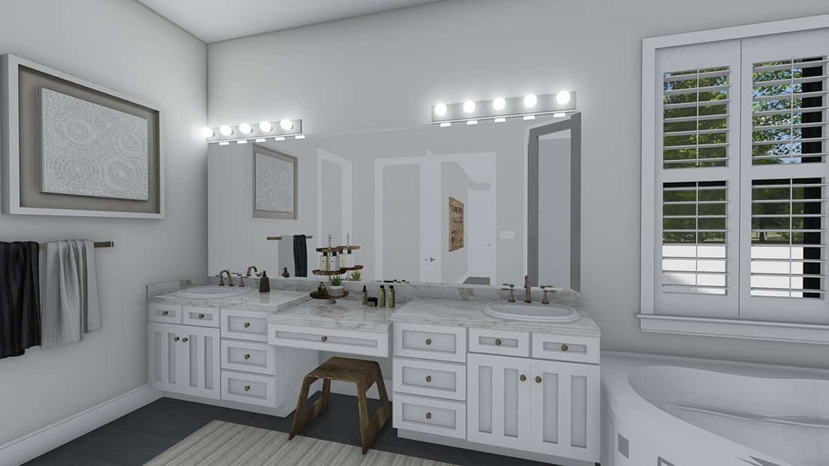 Primary bathroom with a dual sink vanity complemented with a wooden stool.