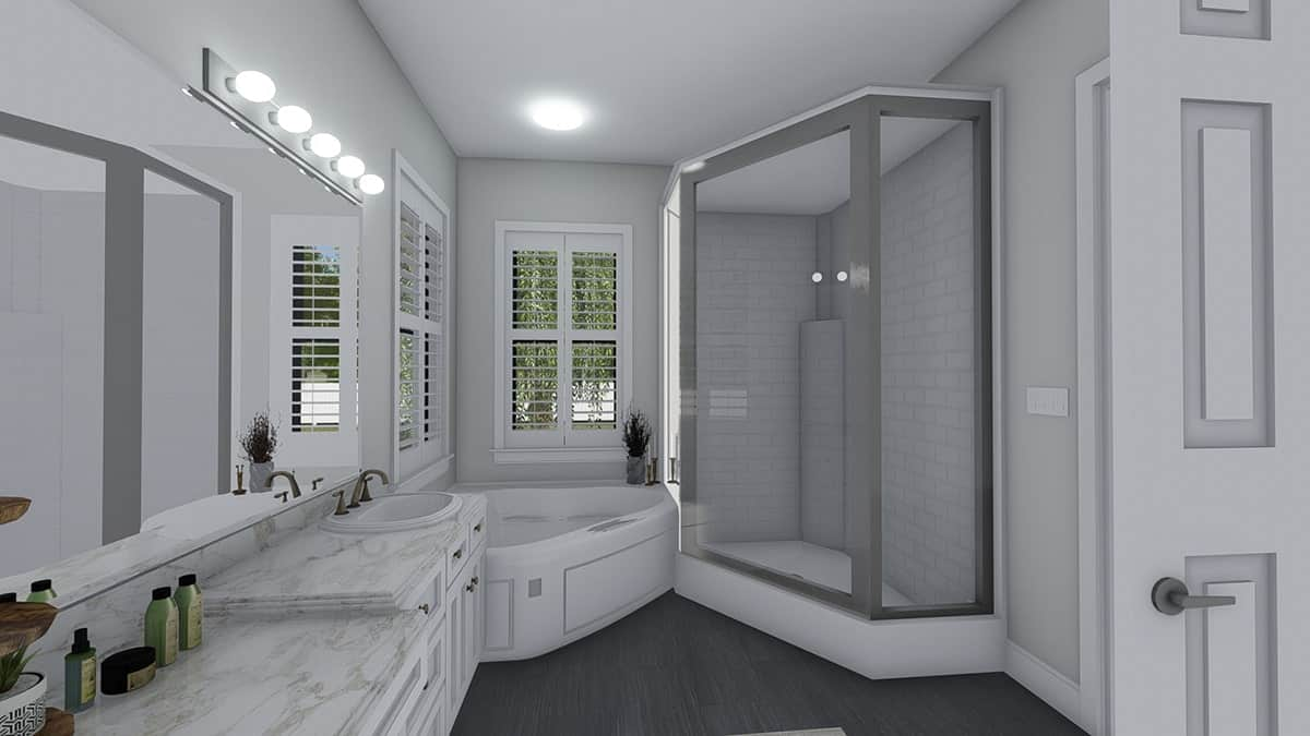 A corner bathtub and walk-in shower complete the primary bathroom.