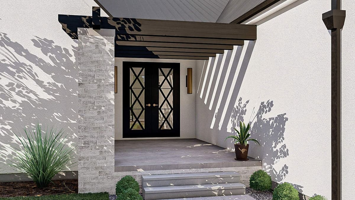 Home entry with a french door and a covered porch topped with a built-in pergola.