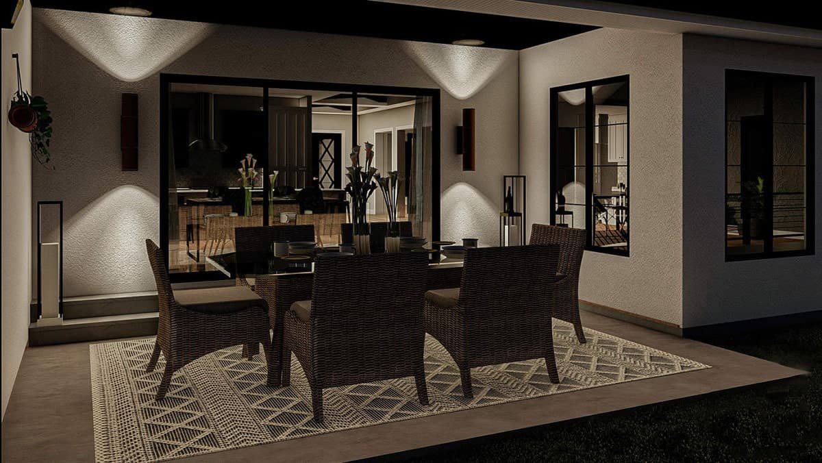 The dining room has a wicker dining set, a patterned area rug, and cylindrical sconces fixed against the textured wall.