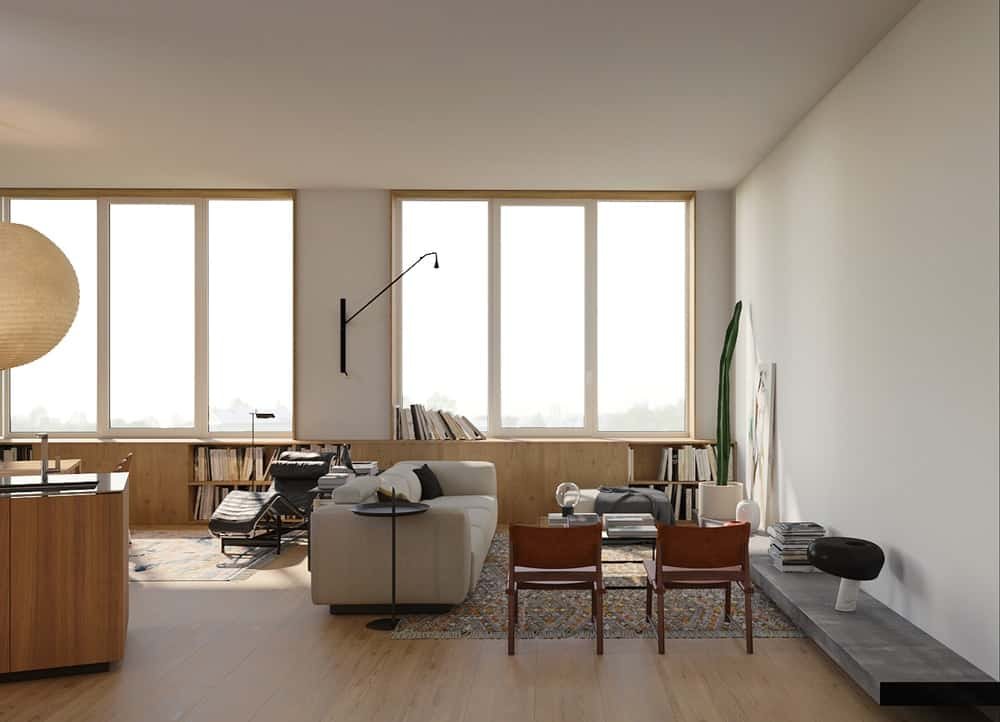 This is a view of the whole living room showing the armchairs and the built-in entertainment shelf that stands out against the bright beige wall.