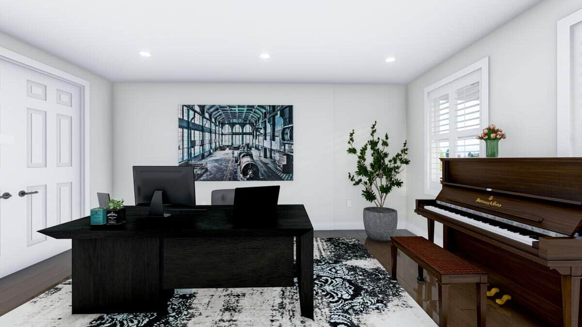 Office with an upright piano and a black desk over a printed rug.