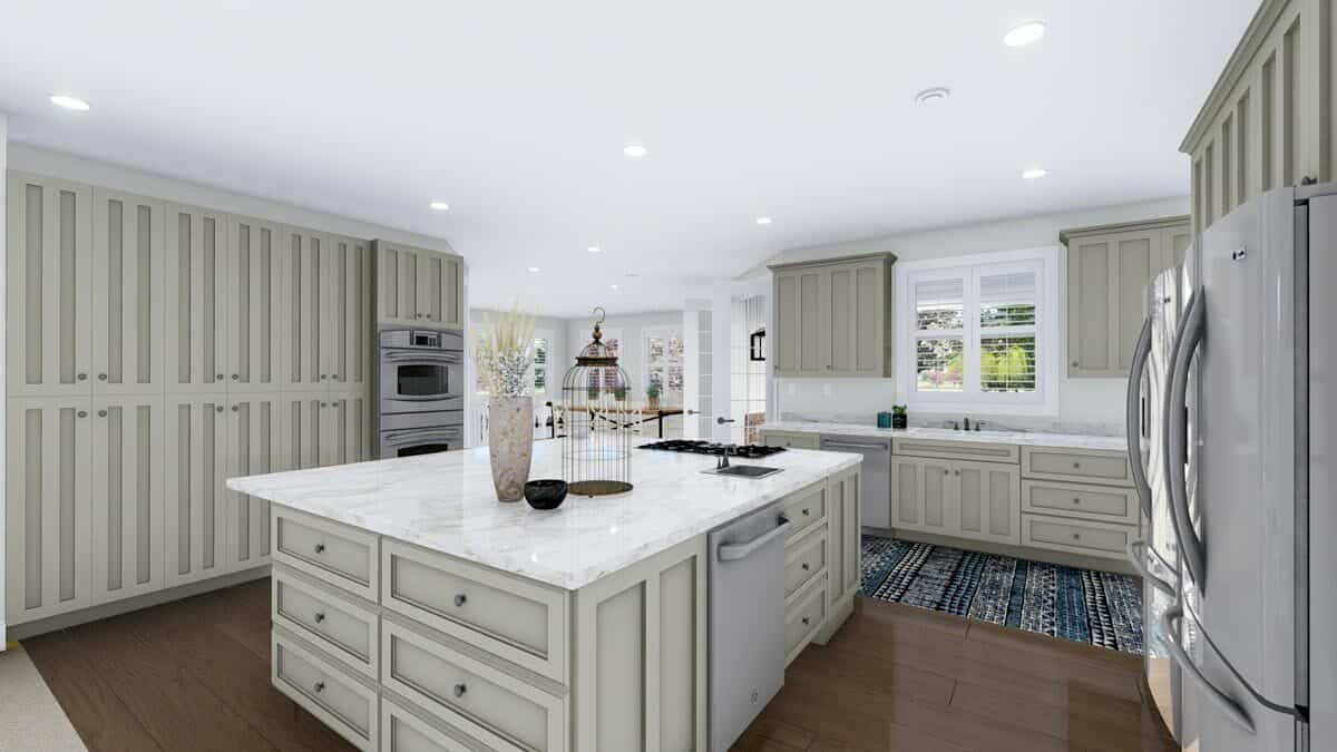 The center island is fitted with a built-in cooktop, a sink, and a dishwasher.