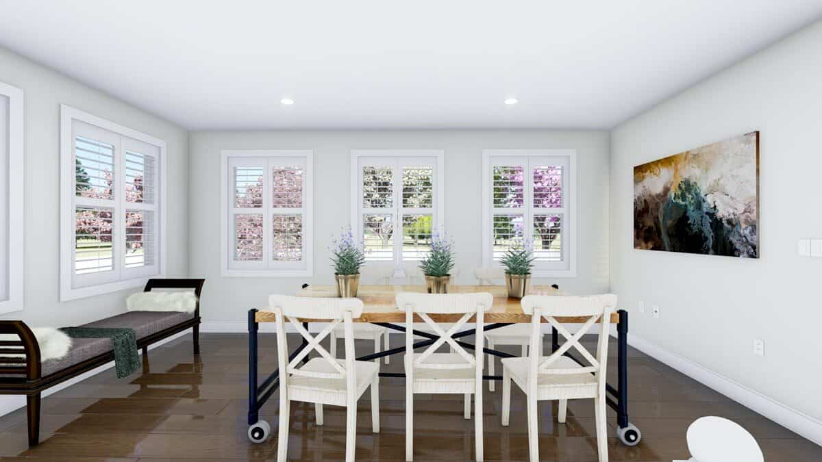 Dining area with a rectangular dining set, a cushioned bench, and a lovely painting adorning the white walls.