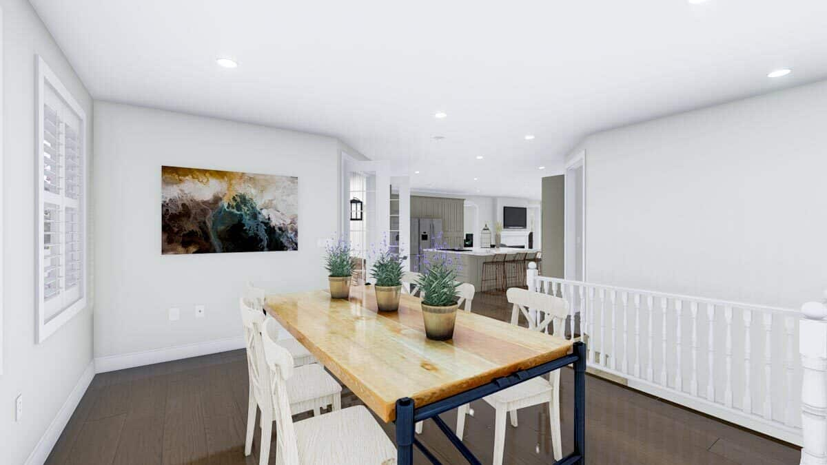 The dining area overlooks the kitchen. A staircase across leads to the basement.