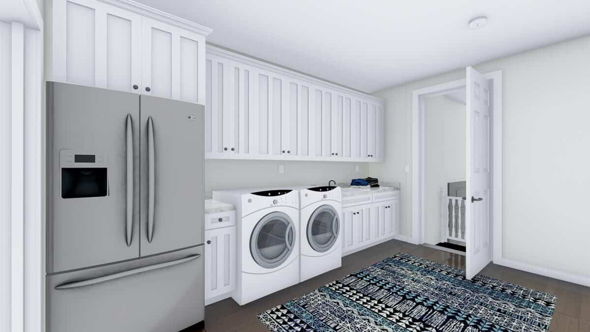 The utility room is equipped with front load laundry appliances, a two-door fridge, and modular white cabinets.