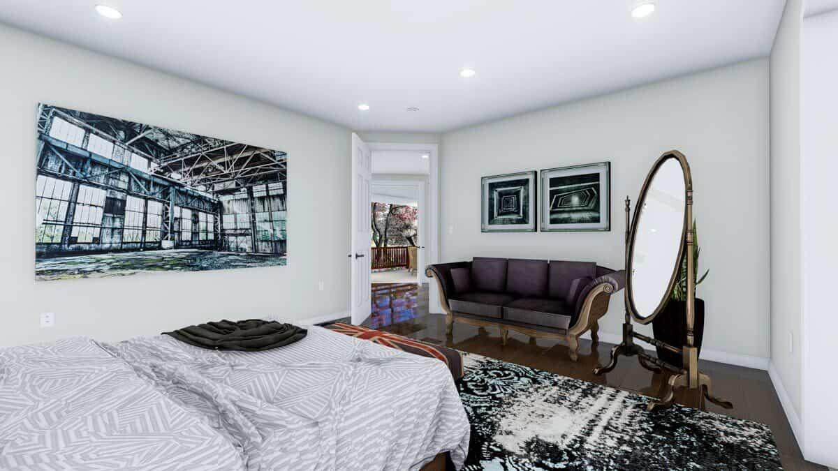 A classy cushioned sofa adorned with a couple of artworks complete the primary bedroom.