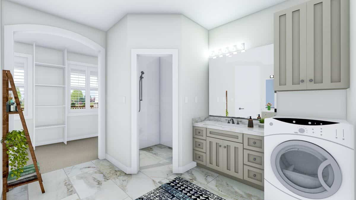 On the other side of the primary bathroom, there's another vanity and washing machine along with a walk-in shower.